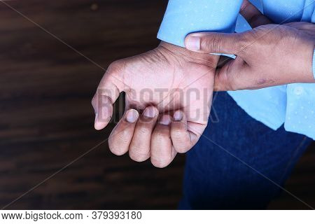 Young Man In Suffering Wrist Pain, Close Up