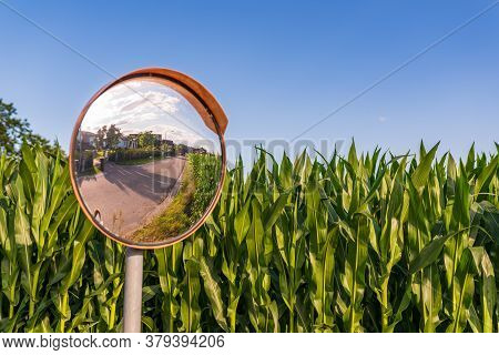 The Traffic Curve Mirror In Rural Area Due Narrow Road And Poor Visibility. Traffic Mirror Safety An