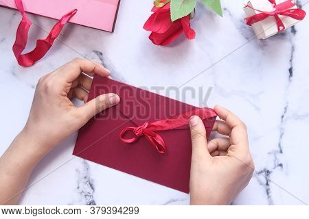 Love Letter In Women Hand On White Background , Top View.