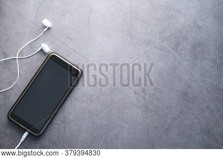 Smart Phone With Empty Screen On Black Background