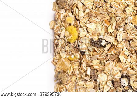 Oatmeal With Raisins, Coconut, Pineapple And Banana Slices Isolated On A White Background. For Packi