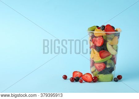 Fruit Salad In Takeaway Cup On Blue Background, Space For Text