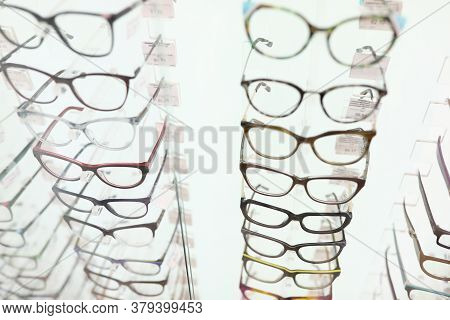 Showcase With Glasses In Optics Salon. Collection Of Stylish Frames Concept