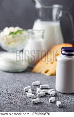 Healthy And Nature Concept: Calcium White Tablet A Good Supplement For Women Bone , In A White Bottl
