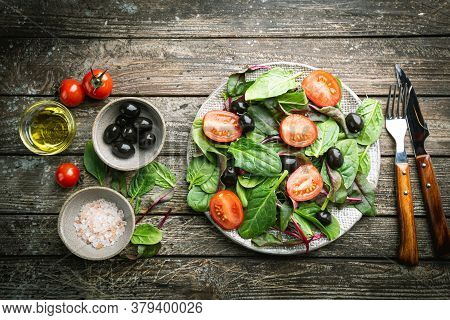 Healthy Salad, Leaves Mix Salad With Mangold, Spinach And Vegetables In The Plate Over Wooden Backgr