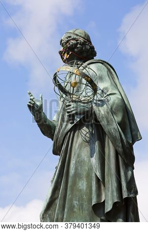 Torun, Poland - June 26, 2020: Nicolaus Copernicus Monument, Statue Of Polish Renaissance Astronomer