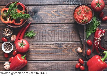 Balkan Sauce Ajvar And Ingredients For Its Preparation On A Wooden Table With A Copy Space. Serbian