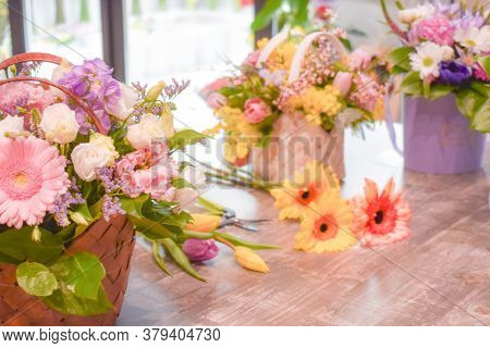 Fresh Flowers In A Basket. Flower Arrangement On The Table. Colorful Blooming Flowers In A Gift Wick