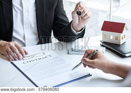 Estate Agent Giving House Keys To Client After Signing Agreement Contract Real Estate With Approved
