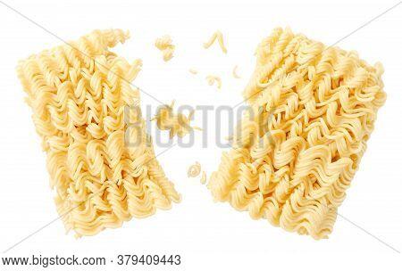Instant Noodles Split In Half On A White Plate. Levitating Noodles
