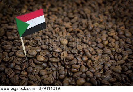 Sudan Flag Sticking In Roasted Coffee Beans. The Concept Of Export And Import Of Coffee