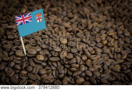 Fiji Flag Sticking In Roasted Coffee Beans. The Concept Of Export And Import Of Coffee