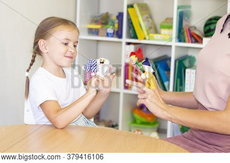 Developmental And Speech Therapy Classes With A Child-girl. Speech Therapy Exercises And Finger Thea
