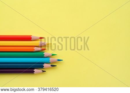 Colorful Pencils On Yellow Background, Flat Lay, Close-up. Set Of Rainbow Pencils, Copy Space. Penci