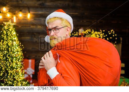 Santa Hat Holds Gifts. Christmas. New Year Gifts. Santa Claus Holds Big Present. Santa Claus With Ne