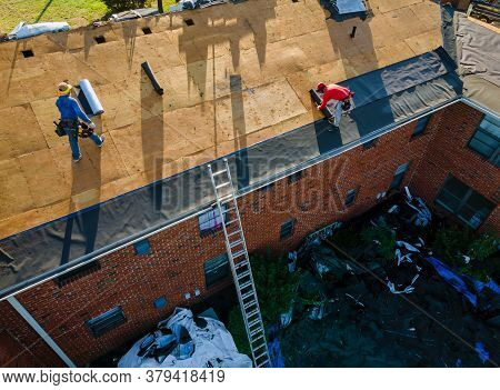 Remove Old Shingle Roof Construction Worker On A Renovation Roof The House Installed New Shingles