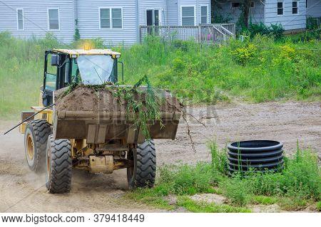 Bulldozer Earthmoving On The Leveling Moving Soil Landscaping Works Using Scoop