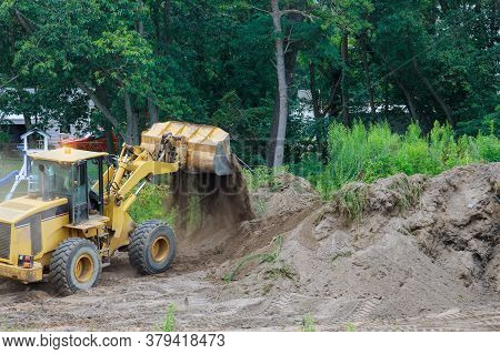 Bulldozer Landscaping Works On Construction Working With Earth While Doing Scoop Excavator