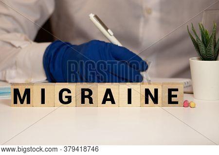 Migraine Word On Block Concept, Medical Concept