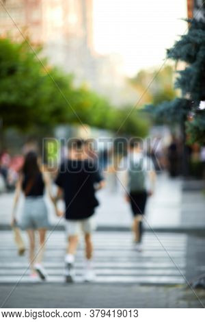 Blurred People Crossing Street In The City. Crosswalk