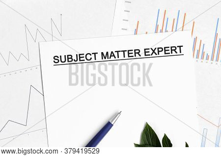 Subject Matter Expert Document With Graphs, Diagrams And Blue Pen