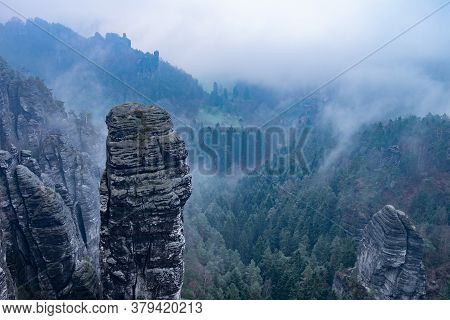 Dark Blue  Highland Scenery Within Misty Weather Aerial View. Rocky Tower. Soft Sunlight Eco Friendl