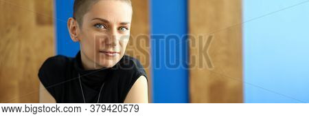 Portrait Of Cute Female Person Looking At Camera With Gladness And Calmness. Smiling Brunette Enjoyi