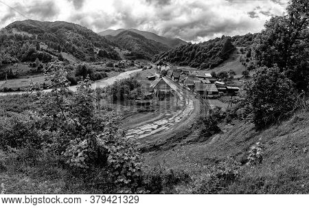 Ecotourism. Rural Landscape. An Old Village In A Picturesque Place Among The Hills And Mountains Ove