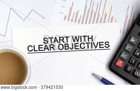 Start With Clear Objectives Document With Graphs, Diagrams And Calculator And A Cup Of Fragrant Coff