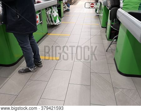 Social Distance. Marking On The Floor In A Store, Market, Pharmacy To Maintain Distance Between Peop