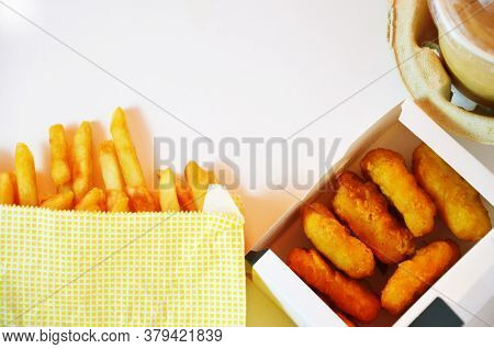 Yummy French Fries, Chicken Nuggets, , Milkshake, Sauce, Latte And Espresso. Paper Bag, White Backgr