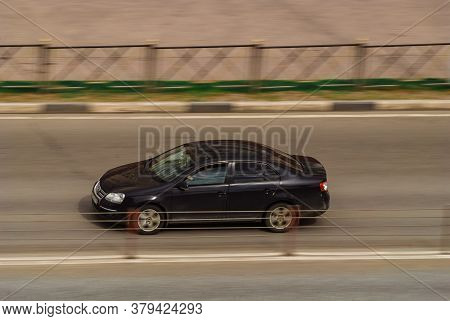 Moscow , Russia - April 30, 2020: Side View Rolling Shot With Black Volkswagen Jetta Car On The City