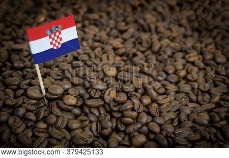 Croatia Flag Sticking In Roasted Coffee Beans. The Concept Of Export And Import Of Coffee
