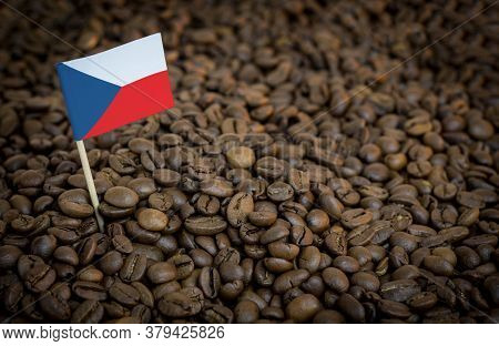 Czech Flag Sticking In Roasted Coffee Beans. The Concept Of Export And Import Of Coffee