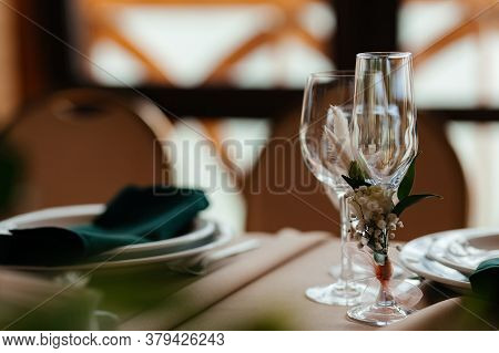 Empty Champagne And Wine Glasses On The Banquet With The Place For Your Text. Background