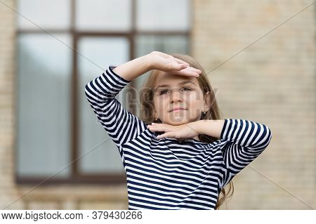 Look That Leaves Impression. Little Kid Hold Hands Around Face Urban Outdoors. Beauty Look. Fashion