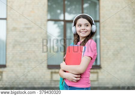 Teen Girl School Student With Stereo Headphones New Technology, Attention To Sound Concept.
