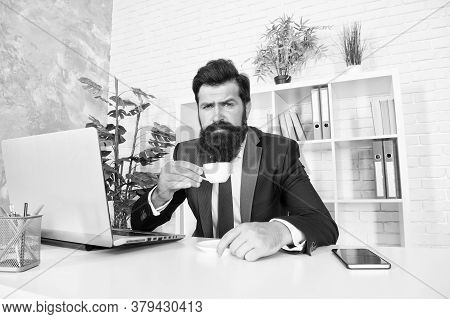 Discuss Business Over Coffee. Respectable Ceo. Man Handsome Boss Sit In Office Drinking Coffee. Comf