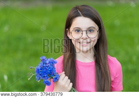 Little Girl Wear Vintage Rim Eyeglasses Green Lawn Background, Beautiful Child Concept.