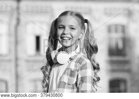 Back To School. Small Girl In Headphones. Listening Audio Book. Free Ebook. Girl In Headphones Liste