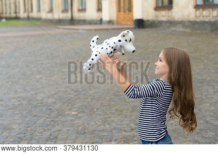 Life Full Of Fun. Happy Kid Play With Toy Dog Outdoors. Enjoying Playtime. Play And Fun. Childhood F
