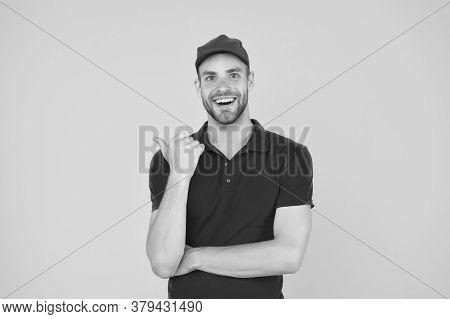 Worker Courier. Friendly Man In Uniform. Portrait Of Smiling Deliveryman. Job And People Concept. Hi