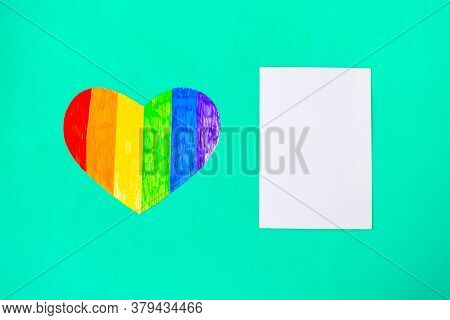 Heart In Lgbtq Colors And White Mockup Blank On Green Mint Background, Top View, Copy Space