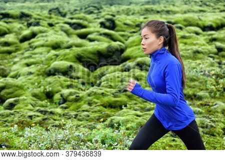 Woman runner training running outdoors. Fitness woman jogging outdoor. Morning running concept. Fit female on run.