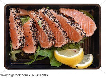 Sashimi salmon raw fish meal on plastic tray