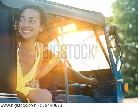 Hot women riding a tuk tuk in asia