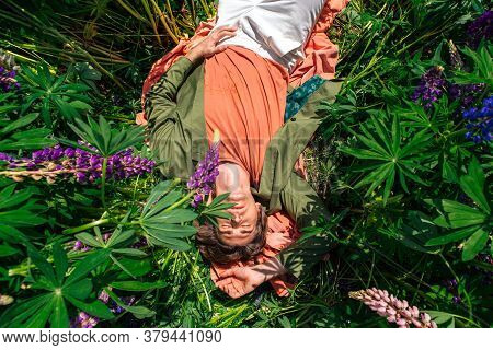 Tall Handsome Lying Among The Lupines Flowers