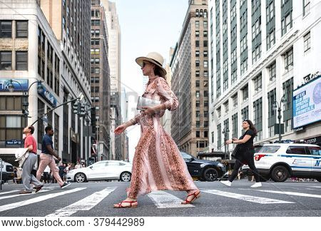 Attractive girl at the crosswalk in New York City. USA 2019
