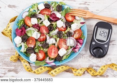 Glucometer With Result Of Sugar Level, Cintimeter And Fresh Greek Salad With Feta Cheese And Vegetab