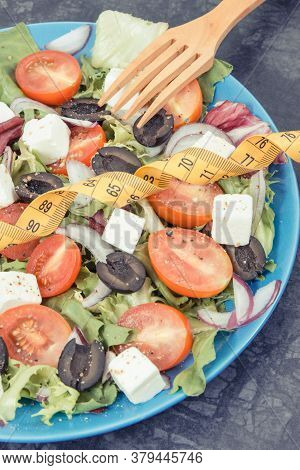 Tape Measure And Fresh Prepared Greek Salad With Feta Cheese And Vegetables. Best Food For Slimming